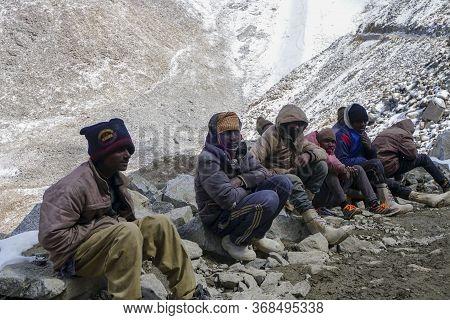 Daily Wages Workers Waiting For Transportation Near Khardungla Pass At 18,000 Feet, Leh Ladakh City,