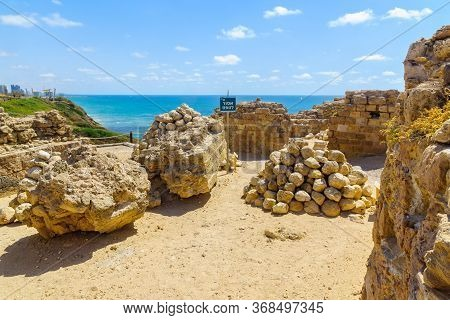 Herzliya, Israel - May 27, 2020: View Of The Crusader Fortress, With A Pile Of Ballista Stones, In A