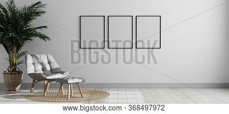 Three Empty Vertical Picture Frame Mockup In Bright Modern Room Interior With Gray Armchair And Palm