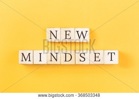 New Mindset Text On Building Blocks On Yellow Background. Change, Success Positive Approach And Flex