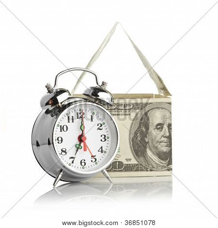 house made of dollars and alarm clock. Isolated on white background. poster