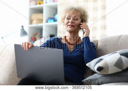 Portrait Of Beautiful Elderly Woman Talking On Mobile Phone Indoors. Businesswoman Holding Modern Co