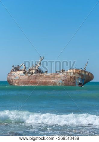 Laayoune Port, Morocco, Western Sahara - January 6, 2019: A Rusty Ship Was Wrecked And Lies On Its S