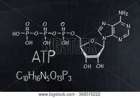 Black Chalkboard With The Chemical Formula Of Atp.