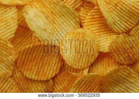 Corrugated Potato Chips. Food Background. Top View.