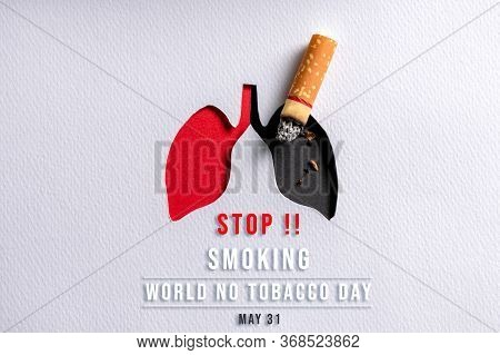 World No Tobacco Day, May 31. Cigarette Burning The Lungs Paper On Black Background. Compare Bad Lun