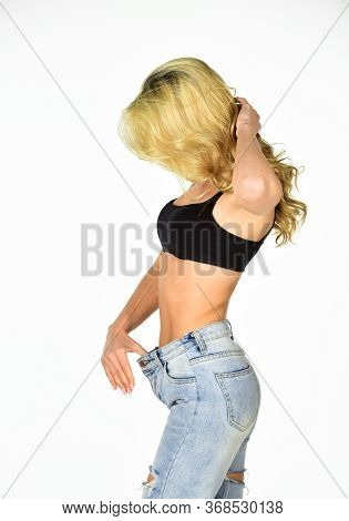Dieting And Fitness. Impressive Result. Girl Shows Big Size Of Her Pants And Slim Belly. Slim Fit Wo