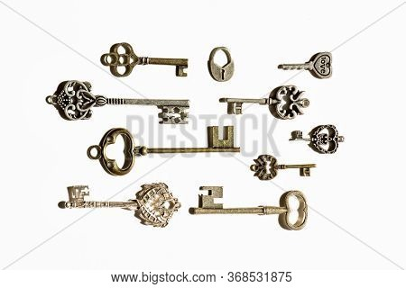 A Lot Of Old, Antique Keys On A White Background, Keys From Safes, Chests, Jewelry Boxes, Differing