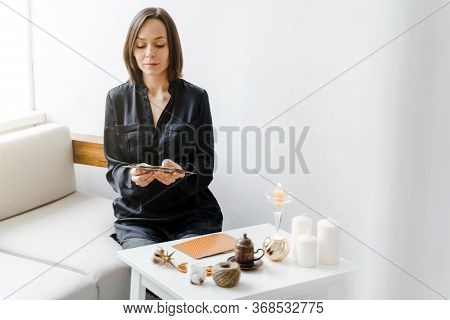 Woman Is Reading Metaphorical Or Tarot Cards On The Table In Home Office. Consultation Of A Psycholo