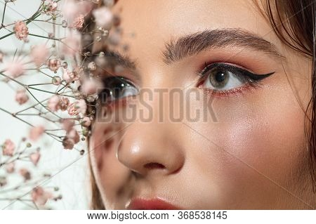 Soft. Close Up Of Beautiful Female Eyes With Eyeliner And Mascara On White Background. Concept Of Co