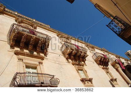 The baroque balconies in Noto