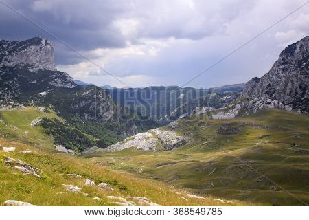 Durmitor Ring Road Panorama In Montenegro National Park. Scenic Landscape Of High Mountains, Green A