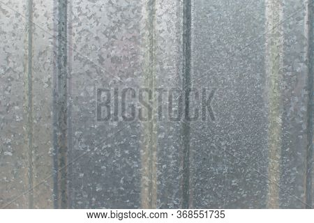 Corrugated Galvanized Iron Plate Texture. Metal Fence Surface Background Close Up