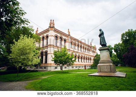 Milan. Italy - May 20, 2019: Facade of Milan Natural History Museum. Museo Civico di Storia Naturale di Milano. Monument to Antonio Stoppani.