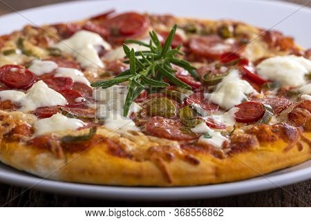 Closeup Of Rosemary Leaf On A Pizza