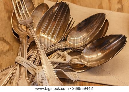 Silverware With Bunch Of Silverware Varieties Including Forks Spoons. Close Up Of Bunch.