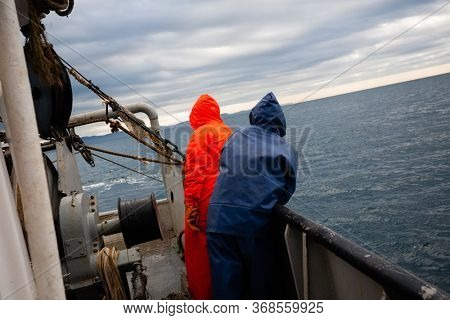 Fishermen on the deck of a fishing vessel in the Sea of Japan