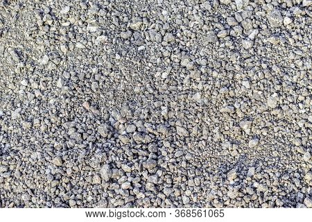 Fragment Of The Surface Of Fine Gray Rubble And Gravel. For Use As An Abstract Background.