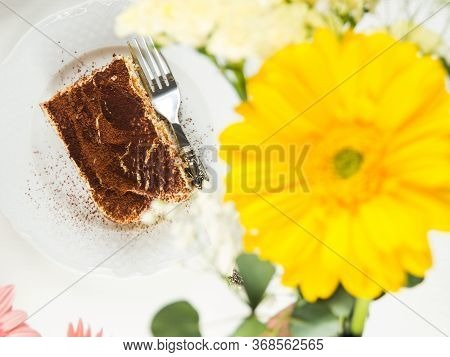 Traditional Coffee Tiramisu Dessert With Mascarpone Cheese And Cocoa Powder Served On Plates On Whit