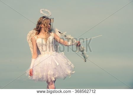 Portrait Of A Cupid Little Girl. Innocent Girl. Space For Text. Arrow And Wings. Cherub Girl. Beauty