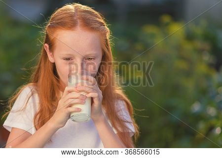 Milk Is Fresh From The Cow - Beautiful Girl With Dairy Products. Healthy Baby Milk - Portrait Beauti