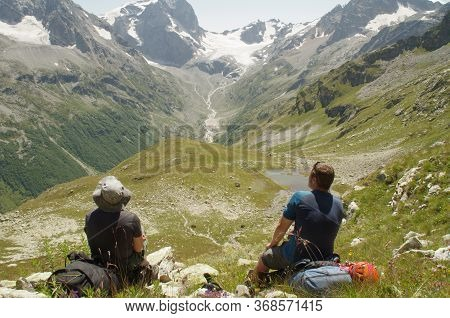 Hikers In The Mountains Sit On A Halt. Hight Quality Photo