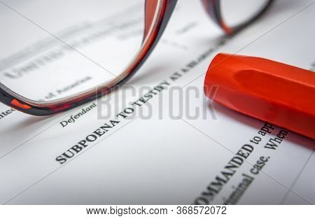 Detail Of A Subpoena For A Criminal Court Case With Glasses And A Pen