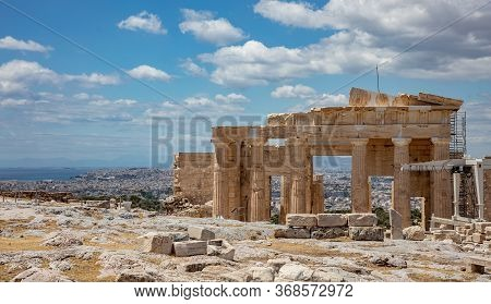 Athens, Greece. Propylaea In The Acropolis, Monumental Gate, Blue Cloudy Sky In Spring Sunny Day.