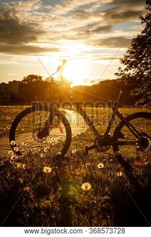 Sports Bike In The Field At Sunset.