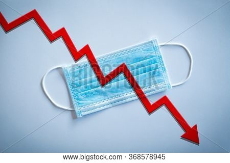 Stock market crash during world pandemic for Covid-19. Healthcare stocks go down in the stock market. Conceptual image of bad news in the stockmarket due to corona virus.
