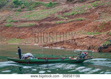 Wushan, Chongqing, China - May 7, 2010: Wu Gorge In Yangtze River. 2 Men Sail On Small Green Ferry S