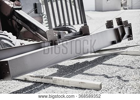 Fork Lift On Gravel Driveway Moving Steel Building Supplies