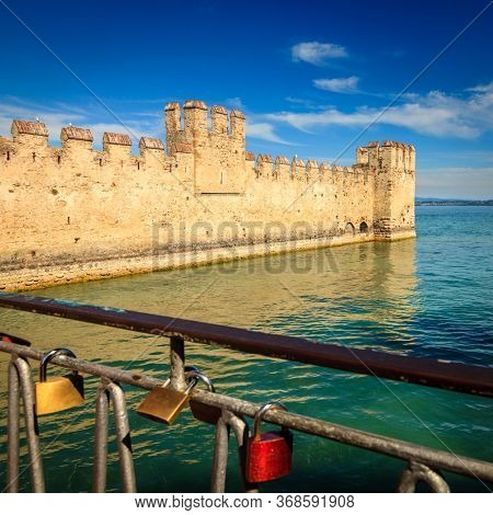 Walls of Scaligero Castle and the Lake Garda in Lombardy, Italy