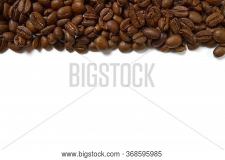 Texture Of Coffee Beans. Roasted Coffee Beans Background. Close Up Coffee Beans With Copy Space On W