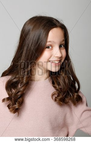 Ten years old girl with long brown hair