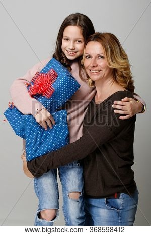 Ten years old girl with birthday present and mom