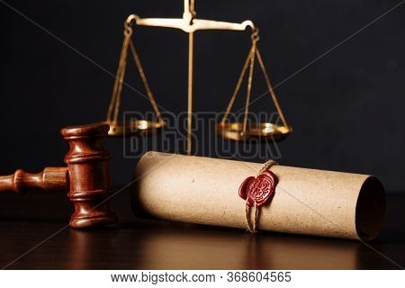 Wooden Gavel And Scales Near Testament And Last Will. Notary Public Tools Close-up