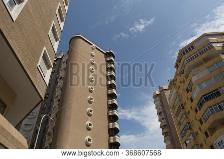 View Of The Modern Multi-storey Apartment Buildings And Sky View. Low Angle View Of Building In Down