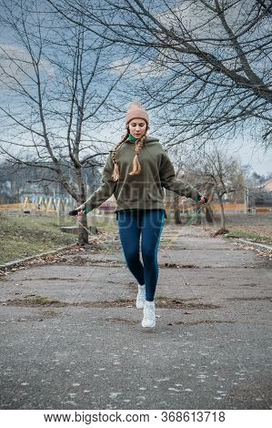 Fitness In The Fresh Air, Outdoor Workout. Safer Outside. Fitness Woman Jumping Outdoor In Urban Env
