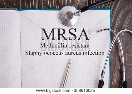 Notebook Page With Text Mrsa Methicillin-resistant Staphylococcus Aureus Infection, On A Table With