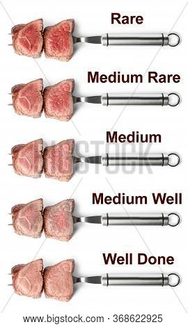 Delicious Sliced Beef Tenderloins With Different Degrees Of Doneness On White Background, Top View