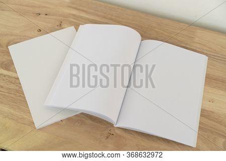 Blank catalog, magazines, book, mock up on wood background.