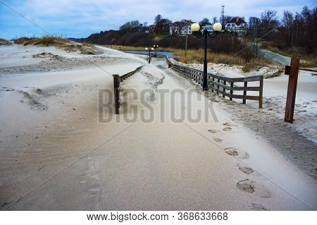 Sand-covered Promenade, Sea Promenade After Storm, Yantarny Village, Kaliningrad Region, Russia, Jan