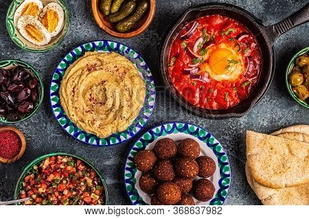 Falafel, Hummus, Shakshuka, Israeli Salad - Traditional Dishes Of Israeli Cuisine. Top View.