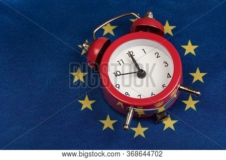 Eu Flag And Vintage Alarm Clock. Close Up. Time To Join The Eu Concept.