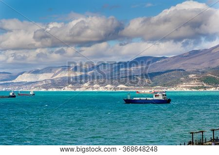 During The Storm, The Ships Are On The Roadstead Of The Port Of Novorossiysk. The Caucasus Mountains