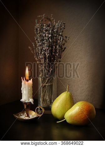 Still Life With Two Sweet Ripe Pears, Candlestick With Burning Candle And Dried Bouquet Of Lavender