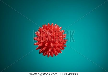 Beautiful Red Massage Ball With Spikes For Stimulation And Circulation, Hangs In The Air On The Ocea