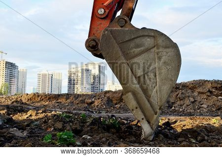 Large Metal Iron Ladle. Excavator Bucket For Digging A Pit And Pipeline Ditch At A Construction Site