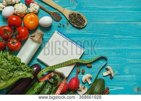 Layout Of Products For An Alkaline Diet, Notepad, And A Centimeter On Blue Boards With Space